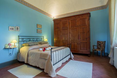 Slaapkamer in luxe vakantiehuis in Toscane