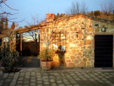 Huisje met eigen tuin en terras, Toscane.